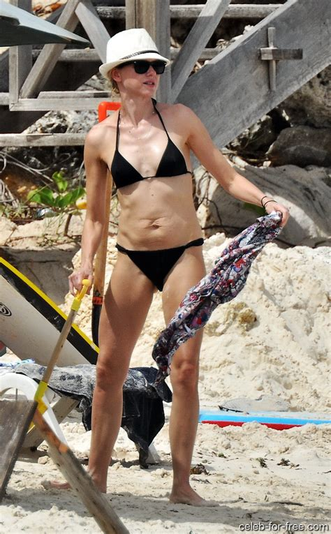 Naomi Watts wearing sexy black bikini on the beach in Barbados
