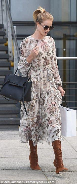 Rosie Huntington-Whiteley looks elegant as she visits M&S ...