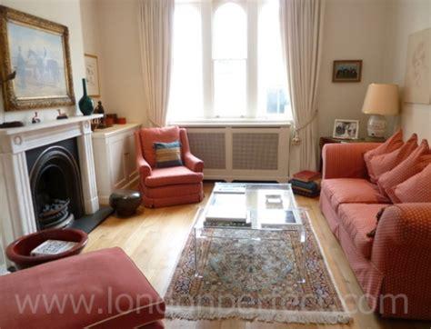 terracotta sofa living room beautiful three bedroom kensington apartment holiday rental