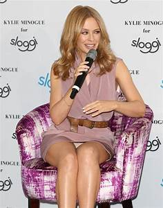 Kylie Minogue flashes her knickers as she promotes Sloggi ...