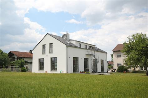 Planungsbuero Schilling by This Garage Transforms Into A Grand Home
