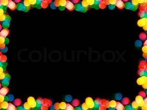 Colorful garland lights looking as frame over black