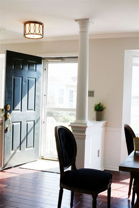 front door opens into living room like the post and half wall to give the feel of an entry
