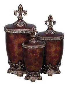 fleur de lis canisters for the kitchen fleur de lis kitchen canisters set of three glass polystone fleur de lis decorative