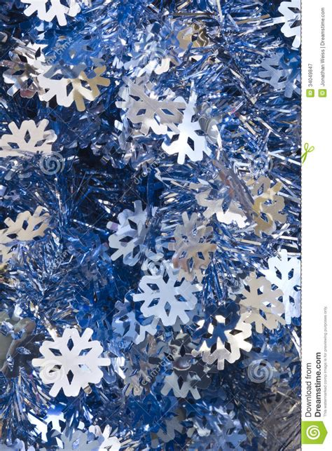 blue and silver christmas tinsel royalty free stock