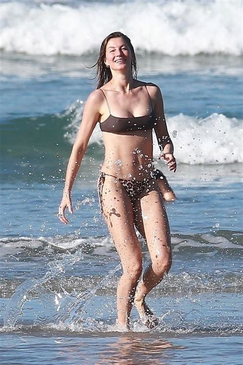 gisele bundchen  fun   beach   revealing bikini