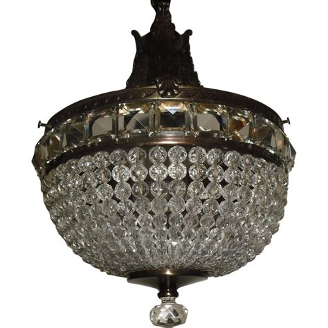 beaded pendant light fixture in decorated brass