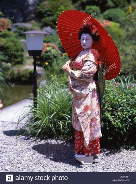 girl  maiko trainee geisha costume  japanese garden