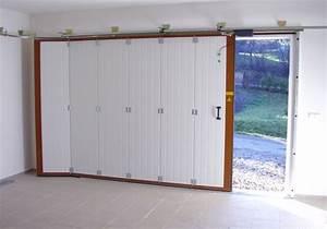 Installer une porte de garage manuelle ou electrique a for Porte de garage enroulable avec ouverture de porte paris