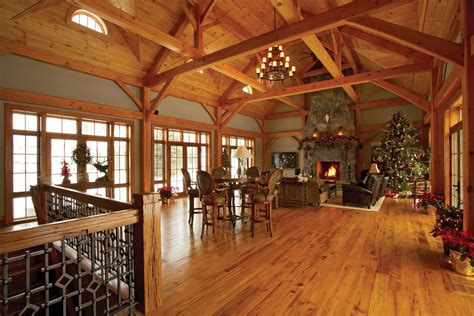 4 Homes With Design Focused On Beautiful Wood Elements by Open Timber Frame Room Walls Of Windows On Both Sides