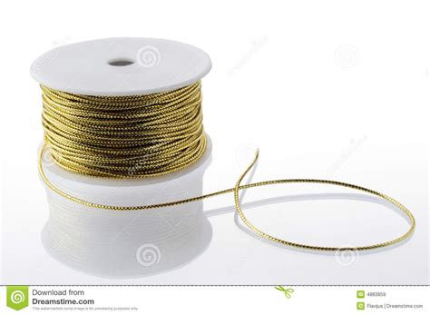 gold string spool royalty  stock images image