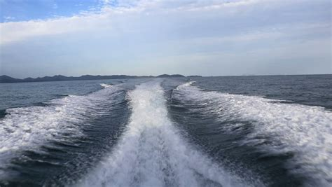 Fast Wake Boats by Blue Ocean Sea Water Wave With Fast Yacht Boat Wake Foam