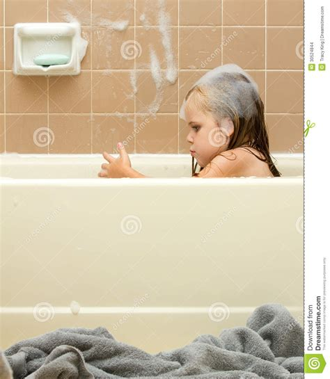 How To Clean Tile In Shower by Young Child Cleaning In The Tub Stock Images Image 30524844