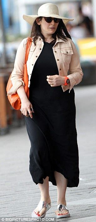 Nigella Lawson back on the beach in slightly less conservative outfit | Daily Mail Online