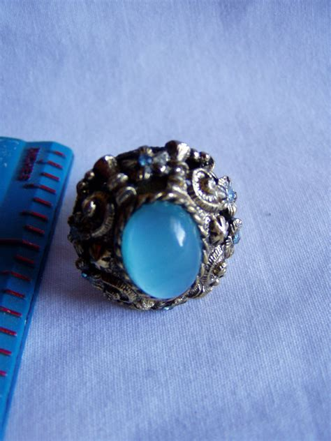 coventry blue stone center with flowers with blue stones adjustable ring r 37