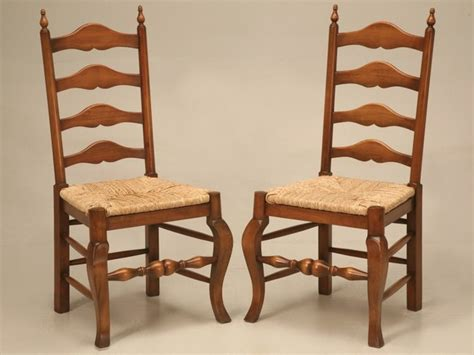 pair of vintage solid oak ladder back side chairs