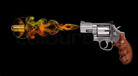 revolver  bullet  black background stock photo