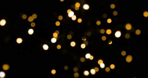 black and gold christmas lights defocused bokeh gold christmas light on dark background horizontal pan stock footage video