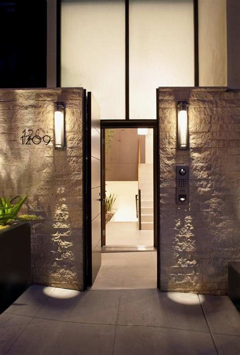 front entrance outdoor lighting entrance of four story contemporary residence with natural