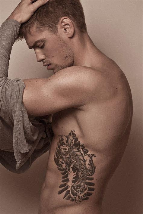 awesome rib cage tattoos  men