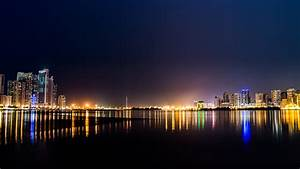 nn03-city-water-river-night-light-bokeh-wallpaper