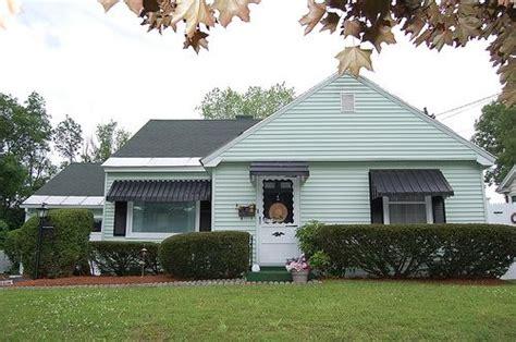 history  repair  window awnings home window awnings aluminum awnings house awnings