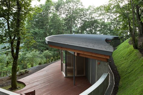 House in hill immersed into rugged landscape
