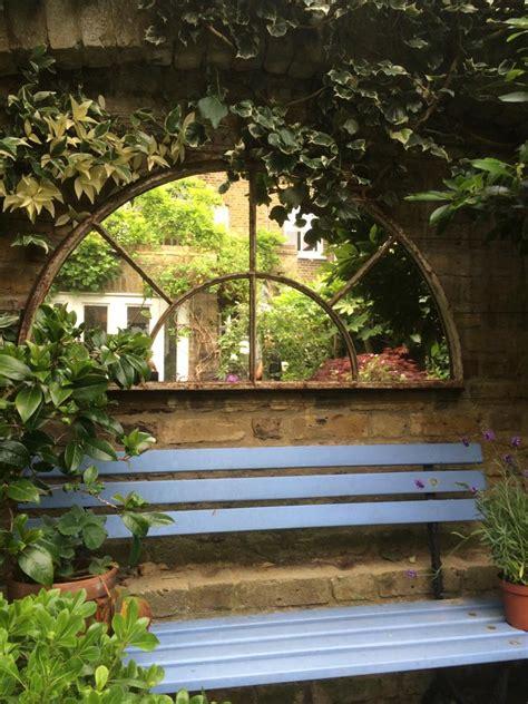 reclaimed garden fan style cast iron mirror