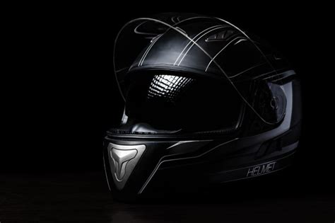 A Black Motorcycle Helmet On Dark Background. Photo