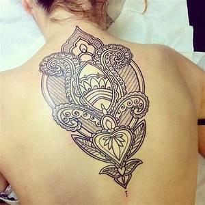 Black lace pattern tattoo on upper back - Tattooimages.biz