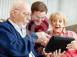 Seniors And Adult Son With Tablet PC Stock graphy
