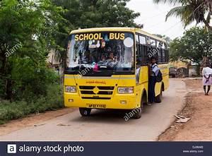Indian school bus going through a rural indian village ...