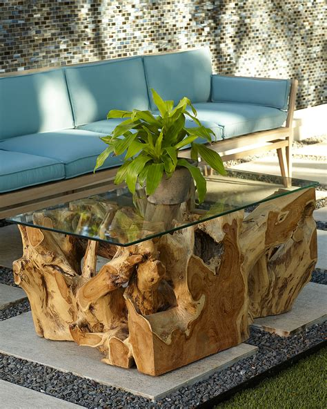 Truly one of a kind and a piece of art, you won't be able to take your eyes off this natural teak root coffee table and neither will your guests. Teak Root Coffee Table with Glass Top | Neiman Marcus