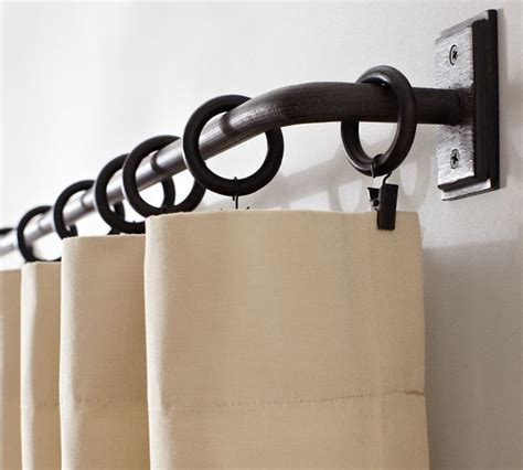 wrought iron curtain rods for corner pretty curtain rod holder the house decorating