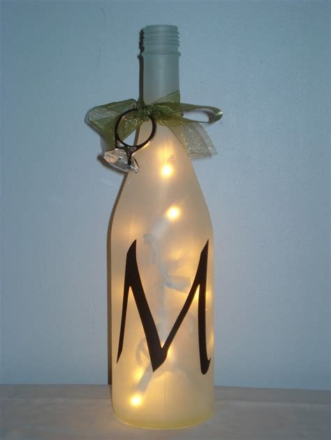 etched painted bottle with lights inside diy crafts