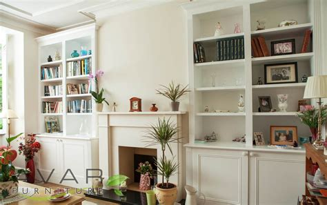 Living Room With Fireplace And Bookshelves by Alcove Ideas