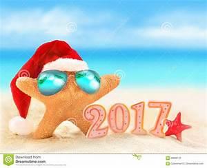 Happy New Year. Starfish In Santa Hat On Summer Beach ...