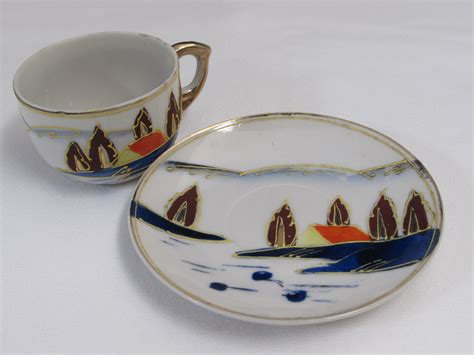 occupied japan hand painted cup  saucer