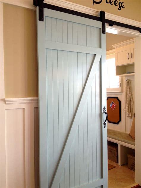 closet door beautiful farm door separating the laundry room from the