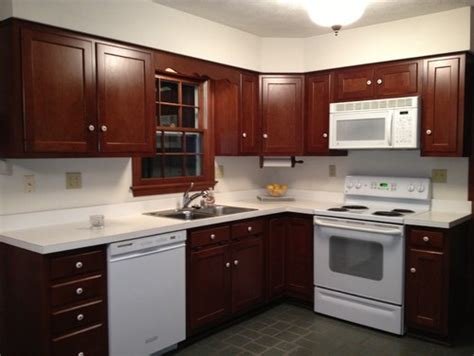 brown cabinets with white countertops brown cabinets white corian countertop w white appliances