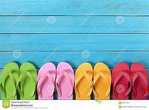 Flip Flops In A Row With Blue Beach Deck Background, Copy ...