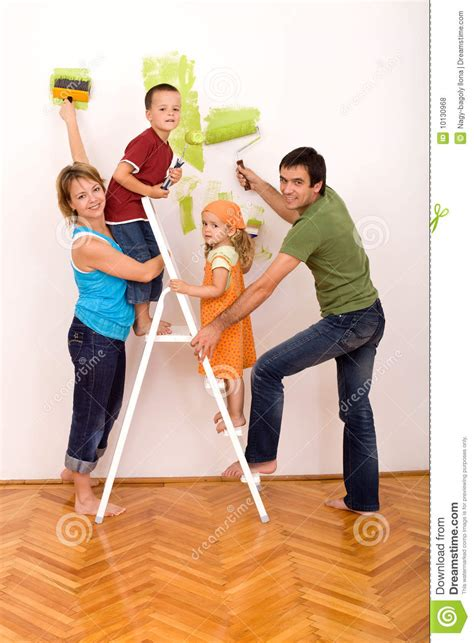 happy family painting utensils royalty stock image