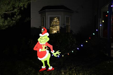 images of grinch decoration pulling down the christmas