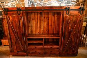 family room entertainment cabinet with barn doors rustic With barnwood door entertainment center