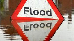 Heavy showers lead to localised flooding warning - BBC News