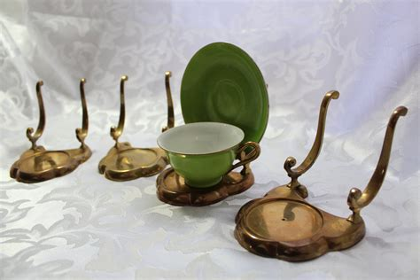 brass tea cup display holders