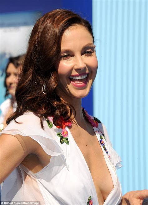Ashley Judd wears a floral dress that offers sneak peek of ...