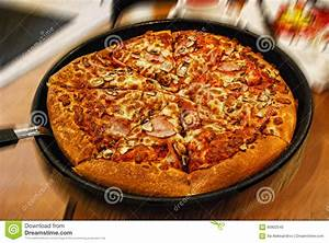 Delicious Italian Pizza In A Pan At Restaurant Stock Photo ...