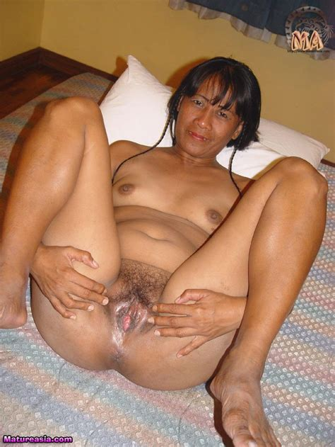 Mature Asian Lisa getting naked and posing nude for her first porn shoot