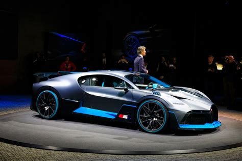 At €5m a pop, it's twice the price of a bugatti chiron, so unless the propshaft is only 40 will be produced (that's 40 on top of the 500 chirons bugatti is already building), and you can't have one. Bugatti Divo Looks Spectacular Under Any Light, Check It Out In 92 Images From Paris | Carscoops